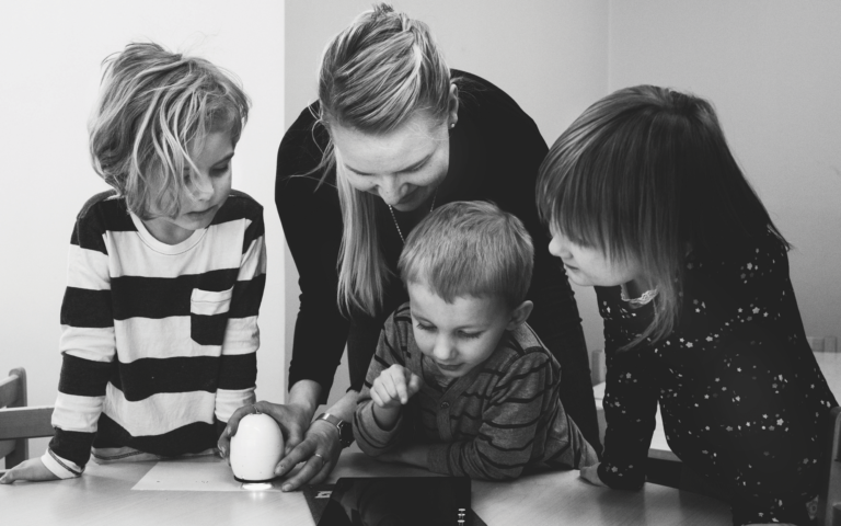 Family looking at a tablet.