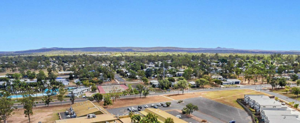 Looking down a hill at Dysart Queensland town (Navicare - the layered care model).