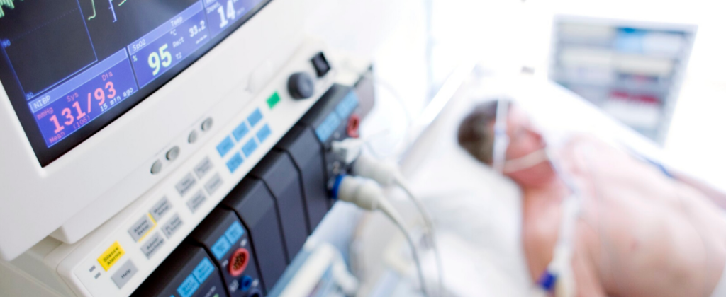 Patient in hospital connected to a respirator machine.
