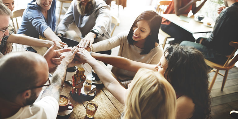 2021 Women in Technology Awards Announced Finalist - people celebrating success with all hands in a 'Go Team' motion.